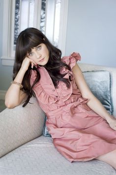 Zooey. Love the dress color, dress, hair, person... I want to be her basically... :)