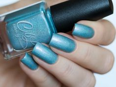 """Arturo - This is the """"mate"""" polish to Katarina. The color of this polish is so hard to describe.  It is a creamy light sky blue aqua creme with intense violet shimmer and scattered holo.  It reads a bit more greyed blue than Katarina.  Swatch taken in daylight shade by @solo_nails on Instagram."""
