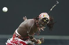 A member of the Maasai cricket warriors bowls during a charity match against former rugby players in Sydney, Australia