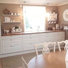 love the colours of this kitchen, kind of looks rose gold