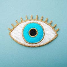 ***LIMITED EDITION ***  This is a gold & blue eye embroidered iron-on patch! This patch is 100% embroidered, so it has a smooth satiny finish, with