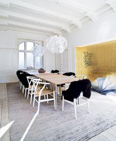 Metallic gold wall in alcove of textile designer Annemette Beck's Danish apt