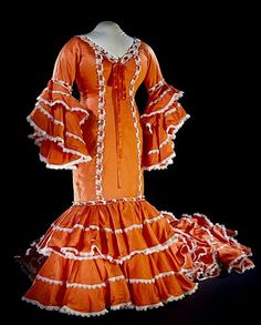 "Today is the 10th anniversary of the death of Celia Cruz. Our curator remembers the ""Queen of Salsa"" on the blog.  This is a Bata Cubana, or Cuban Rumba dress, donated to the Smithsonian by Cruz in 1997."