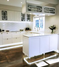 Beautiful white kitchen with a mix of contemporary and traditional feel. Custom designed and made cabinetry with brass detail. New Zealand made kitchen Kitchen Ideas, Custom Design, Kitchens, Laundry, Kitchen Cabinets, Brass, Traditional, Decorating, Contemporary