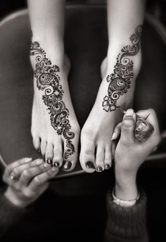 henna in India brides have designs painted on their hands and feet. Some where in the design is the grooms name. If he can't find his name then he can't marry her.