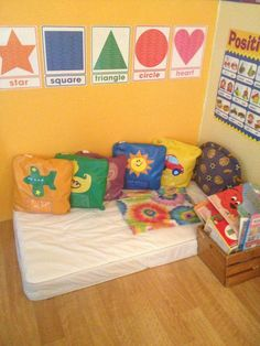 Home daycare reading area. Used a baby mattress, that I was no longer needing. Home daycare reading area. Used a baby mattress, that I was no longer needing. Daycare Spaces, Childcare Rooms, Daycare Setup, Daycare Organization, Toddler Classroom, Toddler Daycare Rooms, Infant Daycare Ideas, Home Daycare Rooms, Preschool Rooms