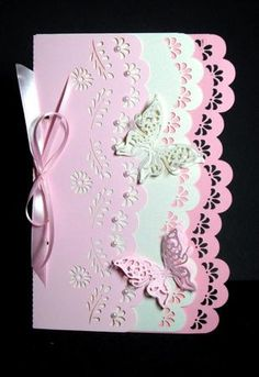 3 layer, lacy edge card, studio on Craftsuprint designed by Lyn Simms - made by Dianne Jackson - I cut out in 2 shades of pink and cream pearl card. I fastoned together through the slots using pink ribbon and added tiny pearls to the top layer. I added 2 Spellbinders die-cut butterflies to finish off this very pretty and delicate looking card - Now available for download!