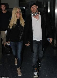 Twins! Jenny McCarthy and her boyfriend Donnie Wahlberg wore matching glasses as they arrived at Los Angeles International Airport in Califo...