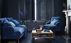 How should you use blue in your home? Dark indigo interior with gorgeous blue velvet sofas - blue on blue - one of the ideas for using dark blue in your home which we take a look at. Read the full feature for more detail and other ideas for going dark this winter.