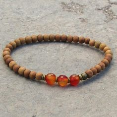 Sandalwood and Genuine Carnelian Gemstone Mala Bracelet. #sandalwood #chakra #bracelet