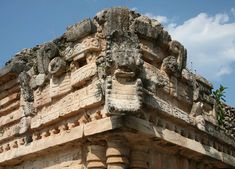 """A decoration on the 120 meter long two-level """"palace"""" at the Maya town of Labna (""""city of abandoned houses"""") which lies on the Puuc route.   As with similar carvings at Uxmal and elsewhere, this one shows the head of the town's ruler protruding from the mouth of a snake which is usually identified as Kukulcan, the Maya version of the Aztec god Quetzalcoatl"""