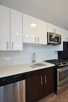 Sneak peek of the West Loop's newest high-rise; Arkadia. Check out those glossy modern white kitchen cabinets. http://www.bestchicagoproperties.com/neighborhoods/west-loop/