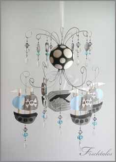 Blue Pirate Chandelier - I'm more drawn to pirates rather than nautical now. It's the almost the same thing...