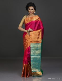 There is an undeniable energy to color red that carries an aura of desire, strength and passion around it. The broad gold border underscores the beauty of this Venkatgiri saree. Venkatagiri Silk Sarees are one of the softest, finest and most durable silk sarees found in India. Famous for their jamdani weaving, lavish pallus and borders that are embroidered intricately using golden thread are the most unique features of our Venkatagiri Sillk Sarees Online.