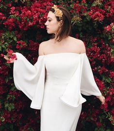 """A real Houghton bride in her off the shoulder silk crepe """"Gamila"""" column gown with horsehair trimmed bell sleeves. Visit the NYC Houghton Boutique to view and try on the full Bridal collection! Email Bride@HoughtonNYC.com to make a private appointment."""