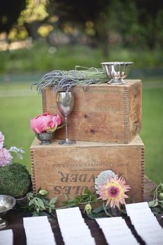 Wood crates and pink flowers.