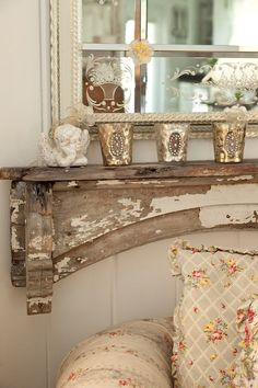 Lovely old mantle. Don't like the metallic candleholders. How about a hand painted vase with dried Queen Annes lace?