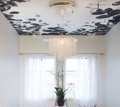 wallpapered ceiling! I've done this with cloud wallpaper, not as easy as it seems but looks good after.
