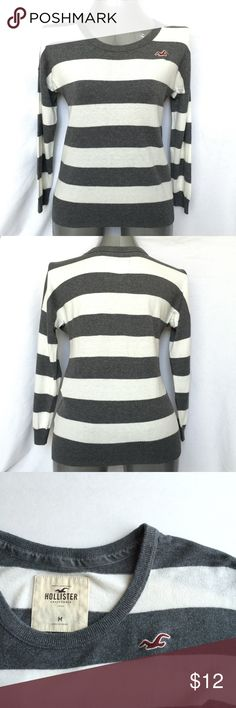 """Hollister Striped Sweater Hollister Striped Sweater  •Gray and Off-white striped crew neck sweater •Only worn a few times - in excellent condition •Very soft knit •Dropped shoulder style •Fabric content: 60% Cotton, 20% Nylon, 20% Viscose •Measurements: bust = 19"""", shoulder to hem = 23"""", sleeve = 17"""" •🚫Trades •🚫Paypal •🚫Lowball offers •All REASONABLE offers will be considered 😊 •Bundle and save 💰 Hollister Sweaters Crew & Scoop Necks"""