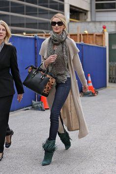 Alessandra Ambrosio showed off her stems in a bohemian-print Ella Moss mini and Rag & Bone boots.