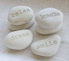 I love these pebbles & collect them. They are all around the house.My son & I also collect heart shaped stones : )  pinned via abeachcottage