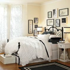 Soft yellow painted walls, with stylish gallery wall, white beding, polka dots pillows....Cozy, beautiful and chic! Will be a dream bedroom for every girl.
