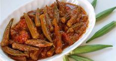 Khoreshteh Bamieh - Okra Stew, made without meat.need to add more salt and/or less water next time, but was still pretty good Lebanese Recipes, Greek Recipes, Lebanese Cuisine, Iranian Cuisine, Okra Recipes, Cooking Recipes, Cooking Cake, Okra Stew, Eastern Cuisine