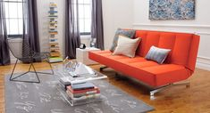 lucite/plastic coffee table #livingroom, interesting shelving unit, #brightcouch