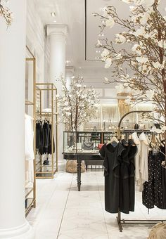 Blossoming trees, an old vitrine, freestanding racks of clothing—all are part of the comfortable setting.