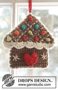 "DROPS Christmas: Crochet DROPS gingerbread house pot holder in 2 strands ""Safran"" and ""Paris"". Crochet Christmas Garland, Crochet Ornaments, Christmas Crochet Patterns, Holiday Crochet, Handmade Ornaments, Diy Christmas Ornaments, Handmade Crafts, Crochet Home, Free Crochet"