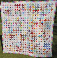 9-patch HST quilt finish | Block Lotto  I would DEFINITELY have to use larger HSTs though.