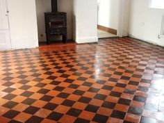 A customer called me out to take a look at restoring the Red and Black Victorian Quarry tiles floor they had discovered under linoleum In the kitchen of their house in the town of Rushden.: