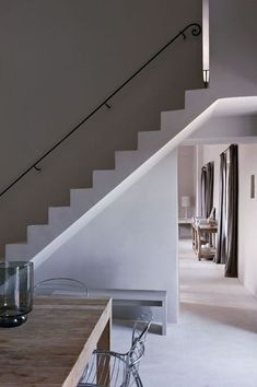 photo: nicolas mathéus. the slim rail against the wall. ideal for my open staircase