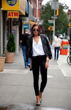 Danielle Bernstein in a white blouse and leather moto jacket