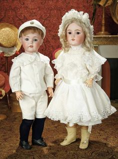 """21"""" Rare German Bisque Character, 600, by Simon and Halbig~~~antique linen boy's costume. Marks: Simon & Halbig 600 10. Comments: Simon and Halbig, circa 1910.~~~22"""" German Bisque Child, Model 99, by Heinrich Handwerck ~Marks: 99-11 3/4 Dep Germany Handwerck 3 1/2 (head) Heinrich Handwerck (body). circa 1910. Value Points: pretty child has original head and body, original body finish, beautiful multi-layered antique costume and bonnet."""