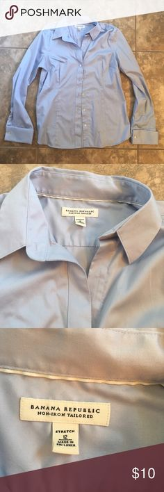 Banana Republic partial button up shirt size 12 Professional light blue button up shirt. Size 12 worn a couple of times Banana Republic Tops Button Down Shirts