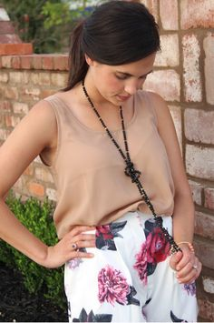 White floral shorts and tan tank #shopsosis #shoponline #sosis #summeroutfit #summershorts