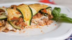 Recipe with video instructions: How to make this easy zuchinni lasagna.  Ingredients: 4 medium zucchini, 2 Tbsp olive oil, 1 small onion, diced, 1 small carrot, diced, 1 stalk celery, diced, 4 cloves garlic, minced ., 1 lb ground turkey, 1 - 1 ½ cups tomato sauce, 6 basil leaves, torn, 6 sheets brown rice lasagna noodles, 1 (15 oz) container skim ricotta cheese, 2 cups grated part-skim mozzarella, ½ cup grated Parmesan cheese