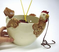 I have had a yarn bowl for years that I love love love, but every time Etsy suggests this chicken to me, I'm tempted to buy it...  ;)