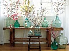 A wedding inspired this spring look. Simple colored glass bottles filled with twigs. Can do the blue dye for glass thing. Bottles And Jars, Glass Bottles, Mason Jars, Apothecary Jars, Spring Branch, Winter Flowers, Spring Flowers, Deco Floral, Floral Design