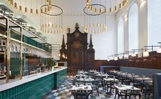 Duddell's | In the Grade II-listed St Thomas Church, a few steps from the looming Shard, the restaurant's Queen Anne exterior, high stained-glass windows, original dark timber wall panelling and ecclesiastical altar sets the tone for local firm Michaelis Boyd's modern aesthetic inspired by traditional 1960s Hong Kong tea houses; set over two levels, bold green and blue-grey hues are revealed through leather banquettes, geometric rubber flooring and a tiled central bar #london #interiordesign