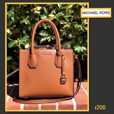 fc246152073a Clothes Mentor · Michael Kors · Brand new and perfect for any season! This Michael  Kors cognac leather crossbody is only. Handbags ...