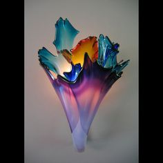 Blown glass-sconce  I love hand-blown glass & color excites me, so this is just astonishingly gorgeous to me! <3