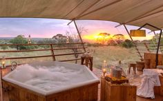 Have you ever rated a travel destination by bathtub views? The editors at Travel and Leisure did, and you have to see some of the destinations they've chosen. Okavango Delta, Jacuzzi, Les Seychelles, Outdoor Tub, The Great Migration, Safari, Hotels, Villa, Bathtub Remodel