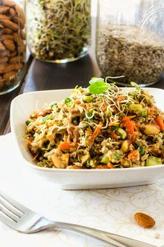 Crunchy Quinoa Salad - With a delicious vinegar and tahini dressing, this colorful quinoa salad is loaded with veggies and protein-packed goodies like lentils quinoa and almonds! Yum!