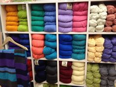 Juniper Moon Farms looks great in our store as well as knitted up!