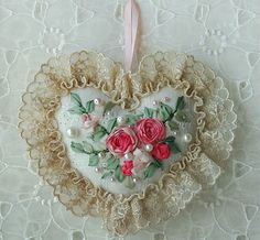 Would love to be able to make this pretty pincushion - love the dainty ribbonwork flowers! :)