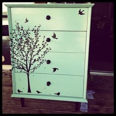 Refurbish old furniture?...I love the design on the front...so pretty... Could use a wall decal instead of trying to paint it! by cledia bertoli