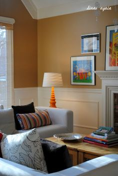 living room. orange lamp. IKEA couches and pillows.gallery wall.