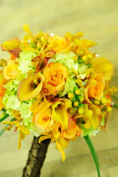 Yellow, orange and light green bridal bouquet